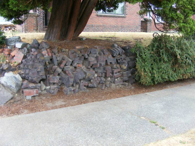 Rubble retaining walls from old brick and sidewalks
