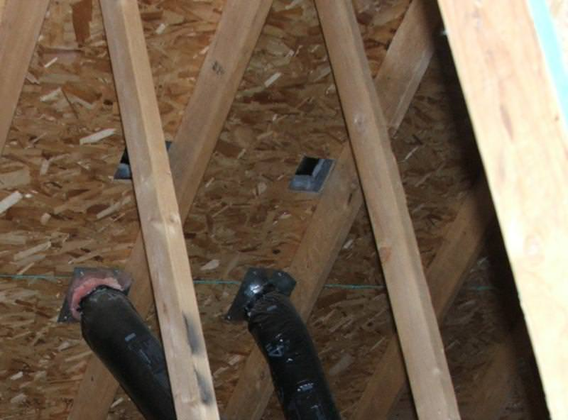 Two vent ducts connected to the bottom of the roof sheathing