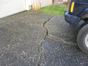 Badly cracked and settled driveway
