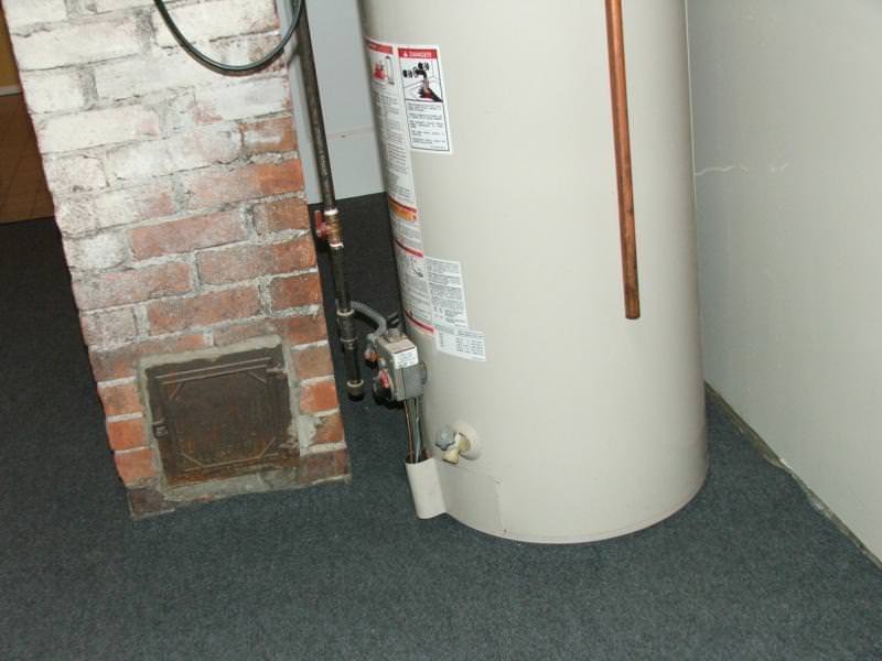 Carpet installed around the air intake of the water heater