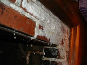 Very heavy efflorescence on the face of a fireplace