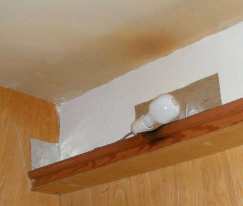Scorch marks from overheating of homemade light fixture