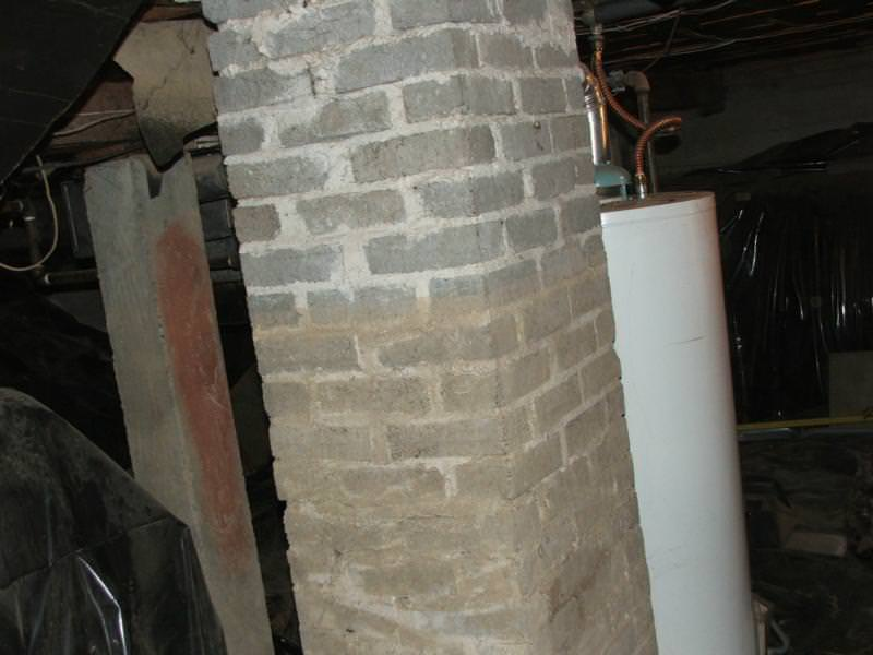 High water line on chimney in basement