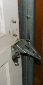 Missing bolts on overhead door hinges is a common defect