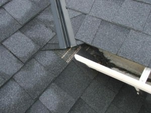 Opened ended gutter draining to roof
