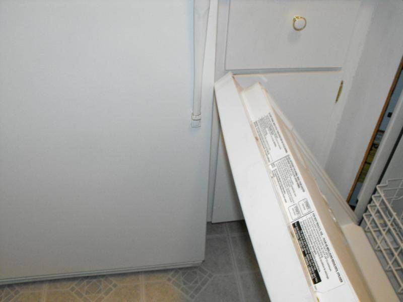 Dishwasher door doesn't open all the way