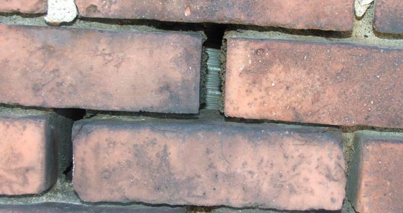Metal liner visible because of missing mortar