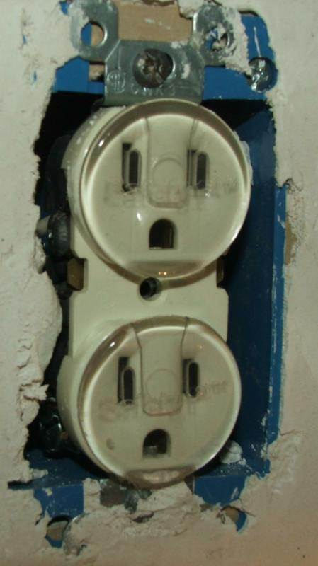 Early version of tamper resistant receptacle