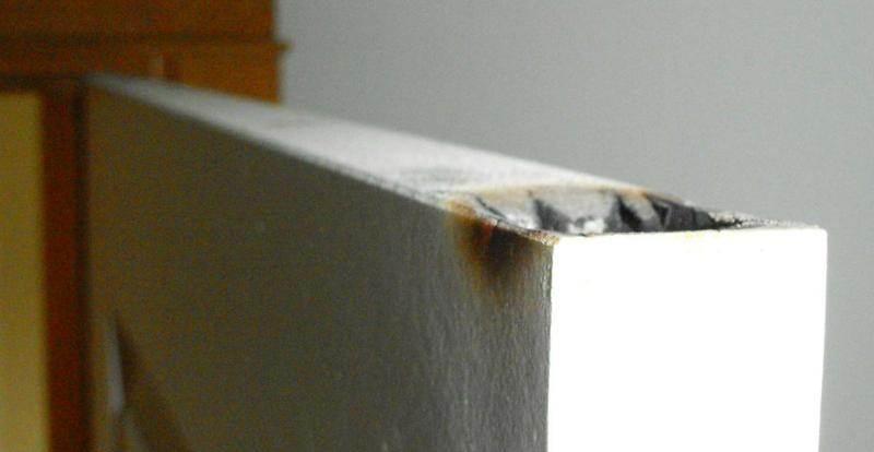 burned top of door