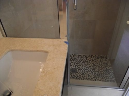 Shower door does not properly clear the edge of the countertop