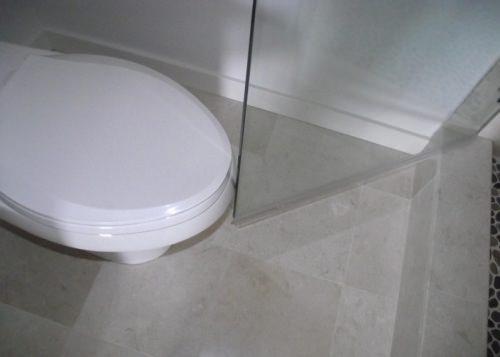 Shower door hits the toilet