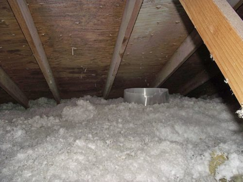 The insulation baffle around the light visible in the attic