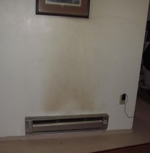 Soot covered walls above a heater