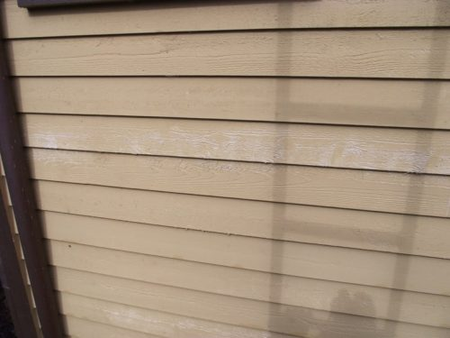 White primer showing where the paint did not cover