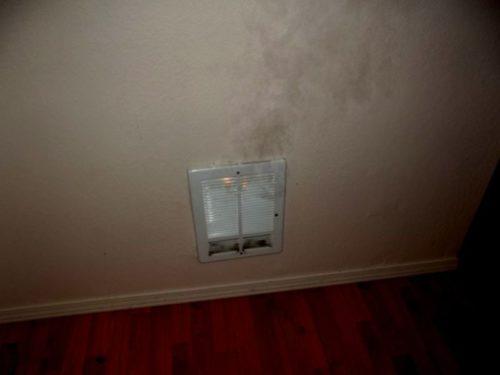 Smoking and flaming wall heater